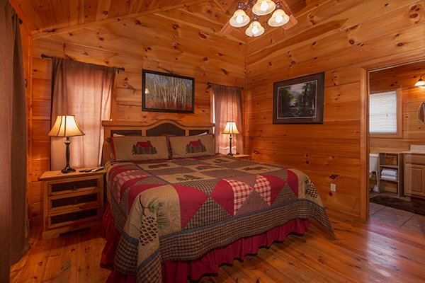 King bed with en suite on main level at Pot O' Gold, a 4 bedroom cabin rental located in Pigeon Forge