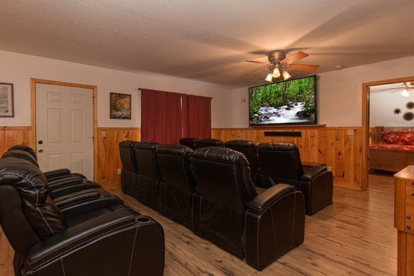 Theater room on the lower level at Pot O' Gold, a 4 bedroom cabin rental located in Pigeon Forge