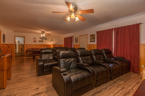 Recliner seating in the theater room at Pot O' Gold, a 4 bedroom cabin rental located in Pigeon Forge