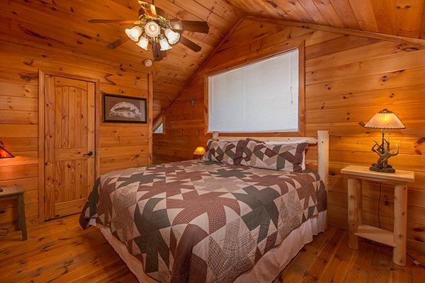 King bed in a loft bedroom at Pot O' Gold, a 4 bedroom cabin rental located in Pigeon Forge