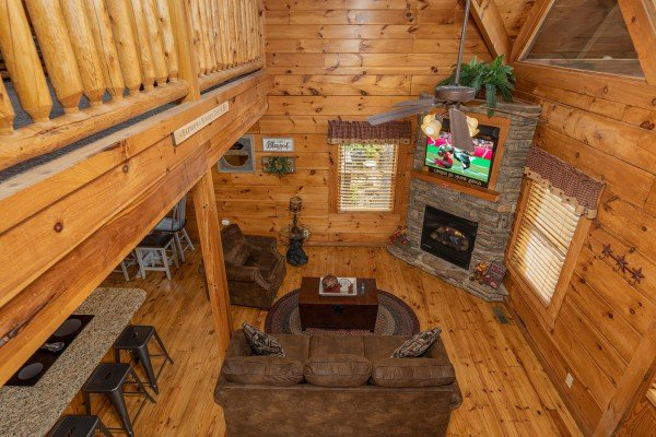 Looking down at the living room at Livin' Simple, a 2 bedroom cabin rental located in Pigeon Forge