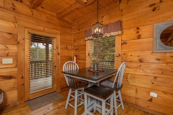 Dining table for four at Livin' Simple, a 2 bedroom cabin rental located in Pigeon Forge