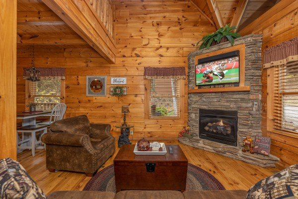 Fireplace and TV in the living room at Livin' Simple, a 2 bedroom cabin rental located in Pigeon Forge