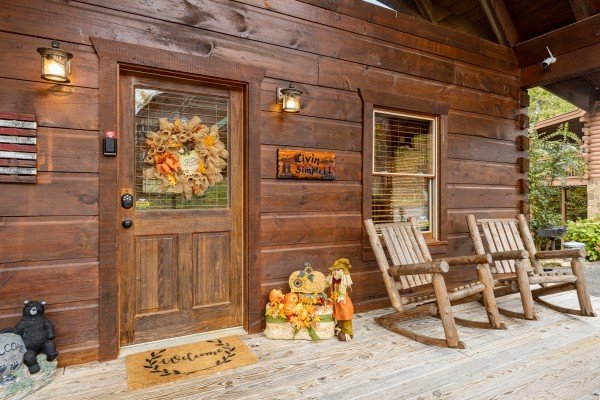 Front door and porch at Livin' Simple, a 2 bedroom cabin rental located in Pigeon Forge