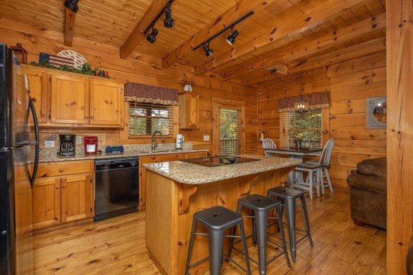 Kitchen with black appliances and granite counters at Livin' Simple, a 2 bedroom cabin rental located in Pigeon Forge