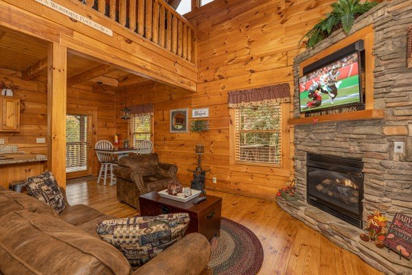 Living room with fireplace and TV at Livin' Simple, a 2 bedroom cabin rental located in Pigeon Forge