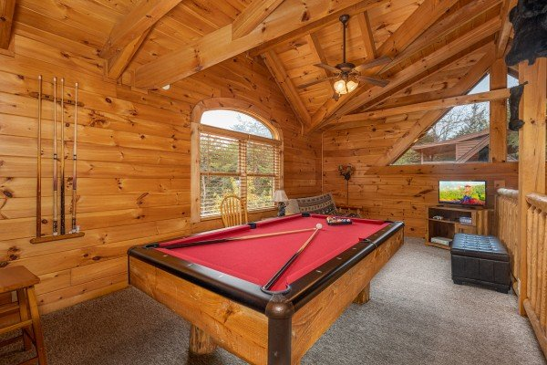 Pool table in the loft at Livin' Simple, a 2 bedroom cabin rental located in Pigeon Forge