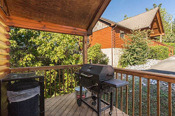 Grill on the covered deck at I Do, a 1 bedroom cabin rental located in Pigeon Forge