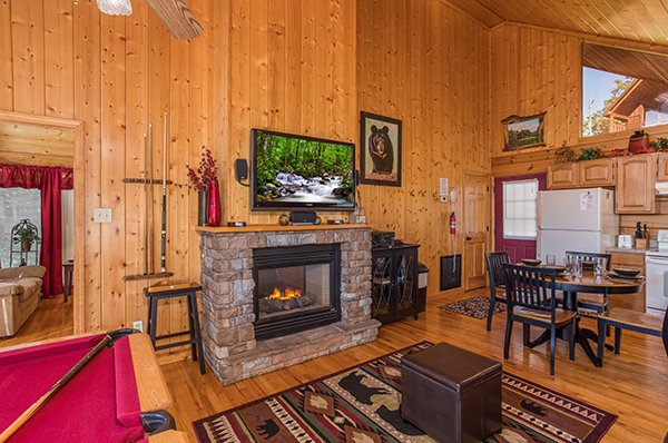 Living room with gas fireplace and TV at I Do, a 1 bedroom cabin rental located in Pigeon Forge