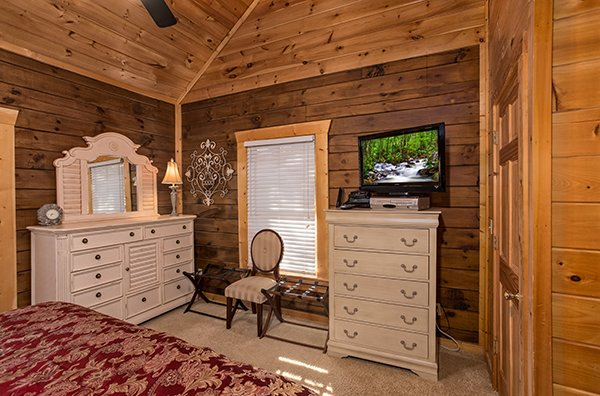 Bedroom with a TV, dresser, and chest of drawers at Mountain Top View, a 3 bedroom cabin rental located in Gatlinburg