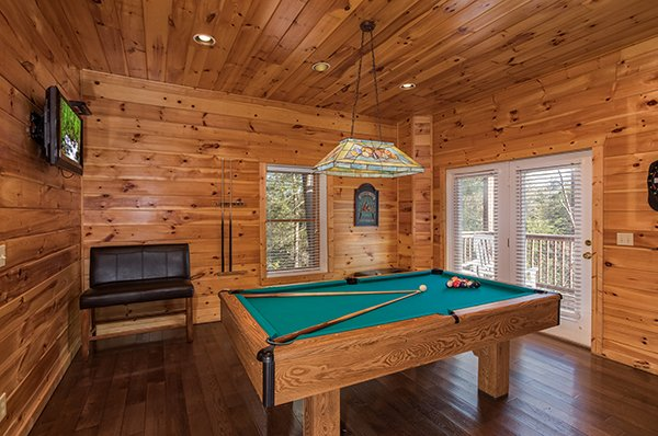 Game room with a pool table and TV at Mountain Top View, a 3 bedroom cabin rental located in Gatlinburg
