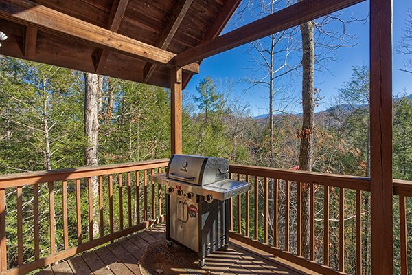 Grill on a covered deck with mountain views at Mountain Top View, a 3 bedroom cabin rental located in Gatlinburg