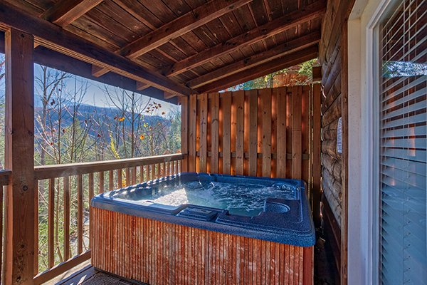 Hot tub with a privacy fence and mountain views at Mountain Top View, a 3 bedroom cabin rental located in Gatlinburg