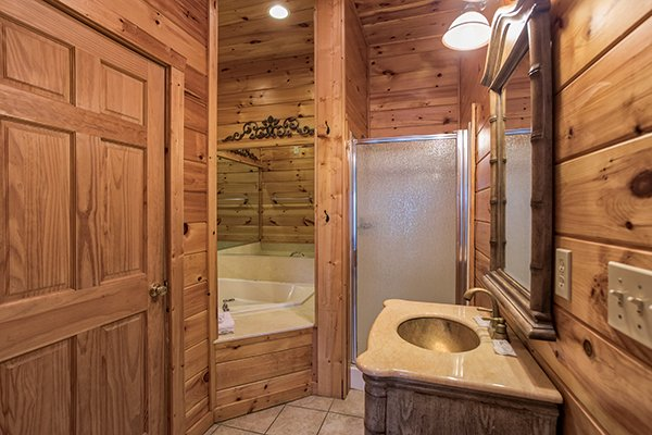 Jacuzzi and a separate shower in the loft bathroom at Mountain Top View, a 3 bedroom cabin rental located in Gatlinburg