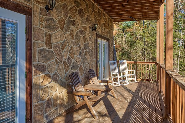 Deck with Adirondack bench and rocking chairs at Mountain Top View, a 3 bedroom cabin rental located in Gatlinburg