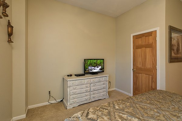 Dresser and TV in the bedroom at Mountain Top View, a 3 bedroom cabin rental located in Gatlinburg
