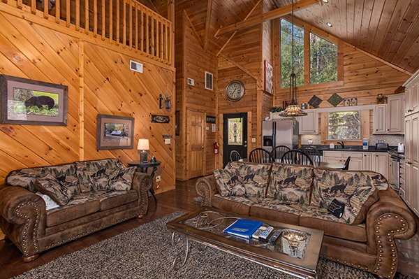 Open concept main floor with living, dining, and kitchen space at Mountain Top View, a 3 bedroom cabin rental located in Gatlinburg