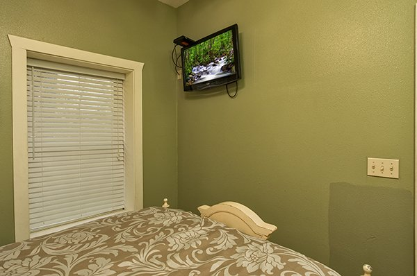 Wall mounted TV in the queen bedroom at Mountain Top View, a 3 bedroom cabin rental located in Gatlinburg