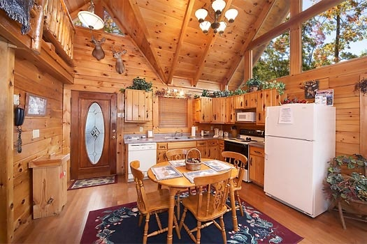kitchen with dining table at gettin' lucky a 1 bedroom cabin rental located in gatlinburg