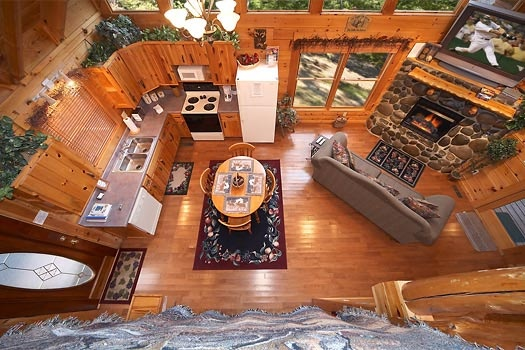 view from the loft of the living room at gettin' lucky a 1 bedroom cabin rental located in gatlinburg