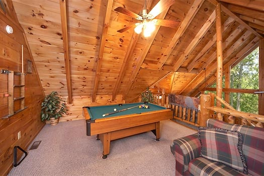 pool table in a lofted game room at gettin' lucky a 1 bedroom cabin rental located in gatlinburg