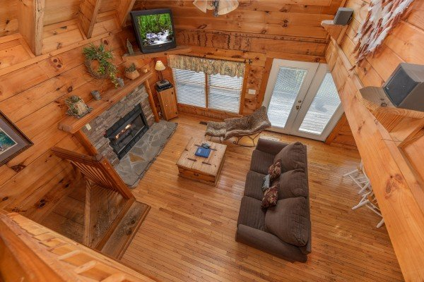 Looking down into the living room at American Beauty, a 2 bedroom cabin rental located in Pigeon Forge