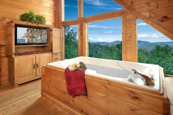 Jacuzzi near a television with a mountain view at American Beauty, a 2 bedroom cabin rental located in Pigeon Forge