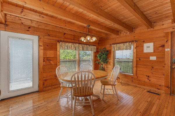 Dining table for four at American Beauty, a 2 bedroom cabin rental located in Pigeon Forge
