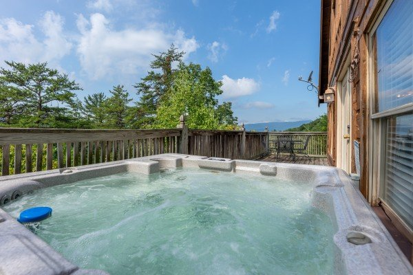 Hot tub with mountain view at American Beauty, a 2 bedroom cabin rental located in Pigeon Forge