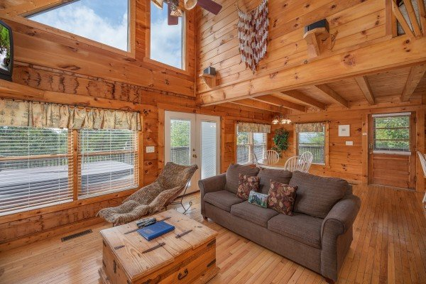 Living room and dining space at American Beauty, a 2 bedroom cabin rental located in Pigeon Forge