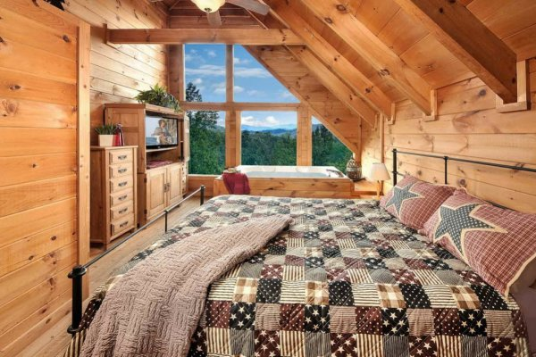 King sized bed with a mountain view at American Beauty, a 2 bedroom cabin rental located in Pigeon Forge