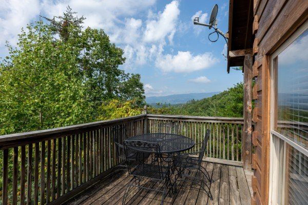 Mountain view and bistro table at American Beauty, a 2 bedroom cabin rental located in Pigeon Forge