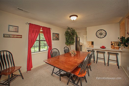 dining room and breakfast bar area at patriot pointe a 5 bedroom cabin rental located in pigeon forge