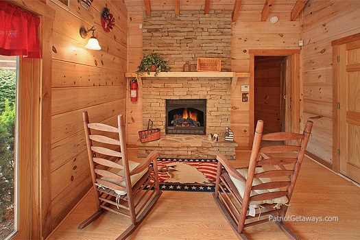 fireplace and rocking chairs at patriot pointe a 5 bedroom cabin rental located in pigeon forge