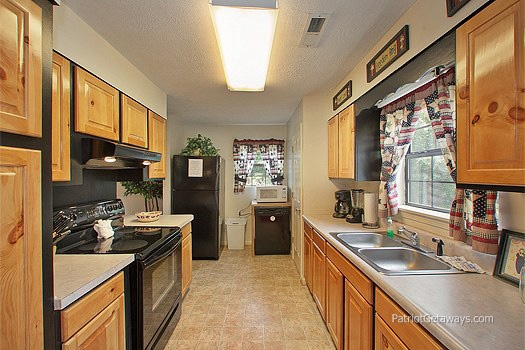 galley kitchen at at patriot pointe a 5 bedroom cabin rental located in pigeon forge
