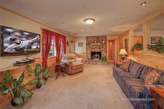 living room with fireplace at patriot pointe a 5 bedroom cabin rental located in pigeon forge