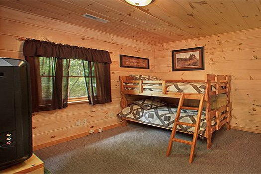 lower level bedroom with at patriot pointe a 5 bedroom cabin rental located in pigeon forge