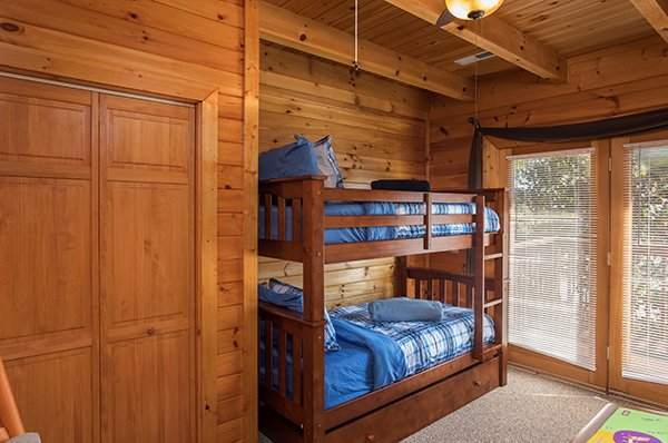 Room with bunk bed and deck access at Lake Life, a 4 bedroom cabin rental located in Sevierville