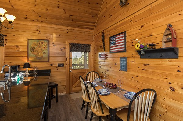 Dining table for four just off the main kitchen at Lake Life, a 4 bedroom cabin rental located in Sevierville