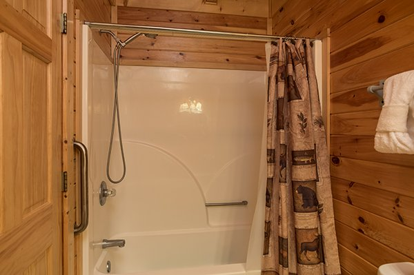 Bathroom with a tub and shower at Lake Life, a 4 bedroom cabin rental located in Sevierville