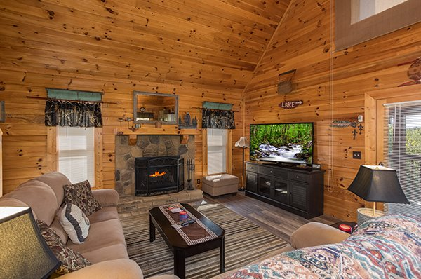 Living room with a fireplace and TV at Lake Life, a 4 bedroom cabin rental located in Sevierville