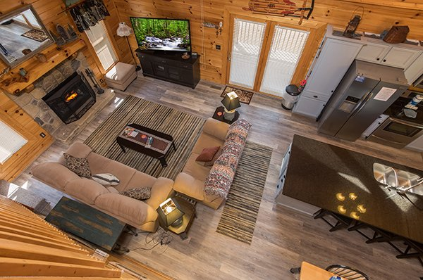 Looking down into the main floor at Lake Life, a 4 bedroom cabin rental located in Sevierville