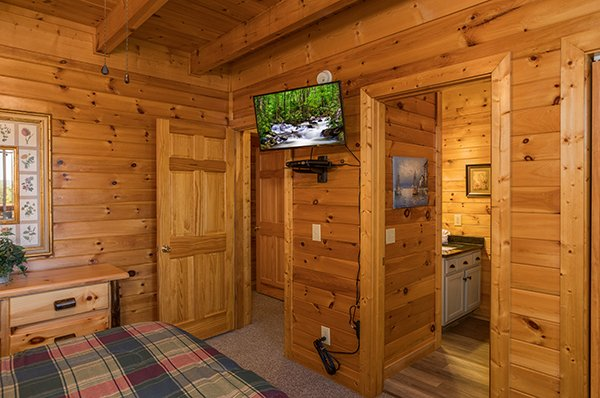 Wall mounted TV and en suite bath at Lake Life, a 4 bedroom cabin rental located in Sevierville