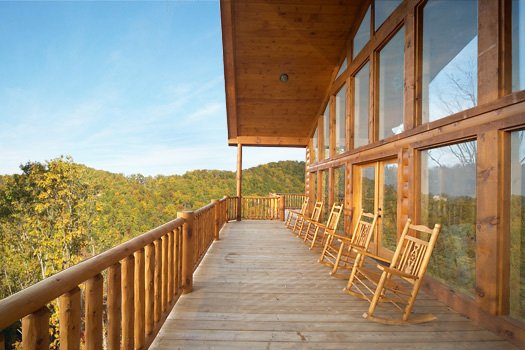 Back deck with rockers at True Grit, a 5 bedroom cabin rental located in Pigeon Forge