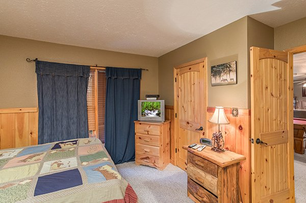 Dresser and TV in a bedroom at True Grit, a 5 bedroom cabin rental located in Pigeon Forge
