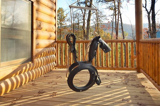 Front porch horse swing at True Grit, a 5 bedroom cabin rental located in Pigeon Forge