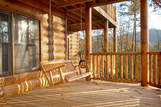 Front porch swing at True Grit, a 5 bedroom cabin rental located in Pigeon Forge