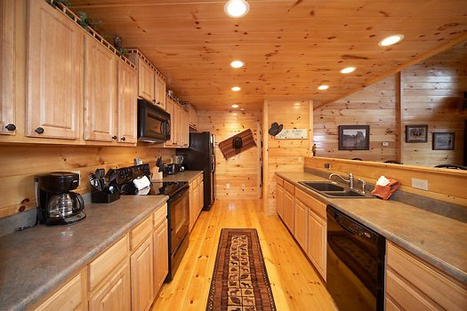 kitchen with bar at true grit a 5 bedroom cabin rental located in pigeon forge