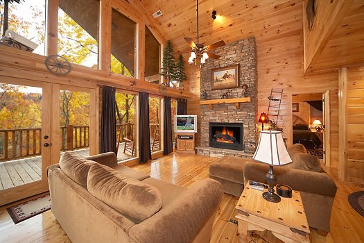 Living room with fireplace at True Grit, a 5 bedroom cabin rental located in Pigeon Forge