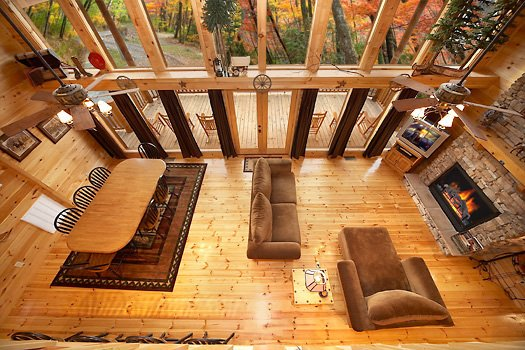 view of living room from loft at true grit a 5 bedroom cabin rental located in pigeon forge